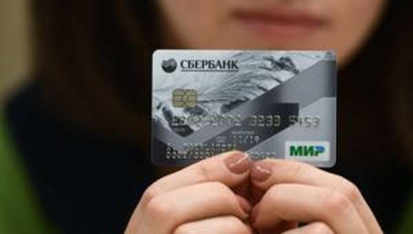 Как положить деньги на карту Сбербанка через банкомат?